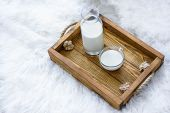 Glass Of Tasty Rice Milk On Wooden Table. Healthy And Tasty Natural Drink poster