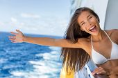 Cruise vacation on cruise travel holiday in caribbean beach. Asian girl with open arm in freedom hap poster