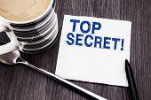 Handwritten Text Showing Top Secret. Business Concept For Military Top Secret Written On Tissue Pape poster