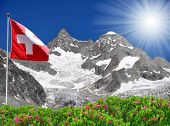 Beautiful mountain Ober Gabelhorn with Swiss flag - Swiss Alps
