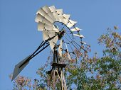 A Miniature Wind Mill Against Blue Sky