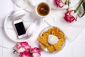 Morning Breakfast With Waffles, Tea And Ice Cream On A Bed , Homemade Food, With Roses And A Phone.  poster