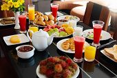 Healthy Breakfast With Bread And Sausage On Dark Wooden Table. Tropical Fruit, Fresh Pressed Juice,  poster