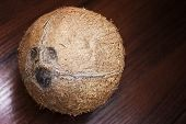 Coconut On A Wooden Background. poster