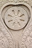 Texture On The Boundary Marker Of A Temple And The Wheel Of The Law