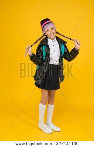 poster of Long And Braided. Adorable Little Child Smile With Long Blond Hair Braids On Yellow Background. Happ