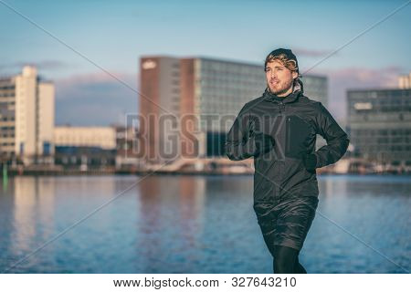 poster of Winter run man jogging outdoor in city harbour running outside wearing cold weather accessories - ha