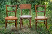 Pair Old Wooden Chair Outdoors. Two Wooden Folding Chairs For Rest. Around The Lush Grass And White  poster