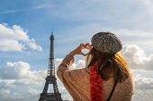 Traveler Girl Making Heart With Hands In Paris. Young Traveler Girl In Vacation. Girl Traveling To P poster