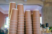 Stacks Upside Down Empty Takeaway Disposable Coffee Cardboard Cups At Cafe poster