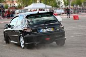 Leiria, Portugal - April 22: Unknown Driver Drives A Peugeot 206 Gti During Leiria City Slalom 2012,