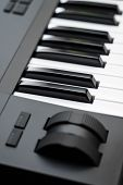 Professional Midi Keyboard Synthesizer With Knobs And Controllers. Modulation And Pitch Wheels. poster
