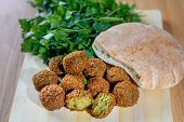 Falafel Balls, Pita And Green Fresh Parsley On Wood Rustic Background. Falafel Is A Traditional Midd poster