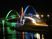 Kubitschek Bridge at night with colored lighting