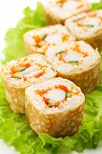 Omelet Maki Sushi - Roll made of Crab Meat, Cucumber and Tobiko inside. Tamago (Japanese Omelet) ous