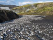 Snow Field At Landmannalaugar Colorful Rhyolit Mountains With Steam From Hot Spring On Famous Laugav poster