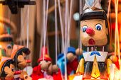 Wooden Pinocchio Dolls With Long Nose. Conceptual Fairy Tale Character. poster
