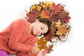Haircare Tips Add To Fall Routine. Little Girl Gorgeous Long Hair And Fallen Maple Leaves Lay On Whi poster