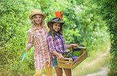 Agriculture Concept. Girls Planting Plants. Planting And Watering. Cheerful Children Working In Gard poster