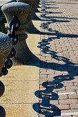 Heavy Iron Link Fence Reflecting On Brick And Tiled Walkway Near Lake Erie In Cleveland poster