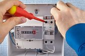 An Electrician Installs Of Electrical Panel With Circuit Breakers And An Electricity Meters In A Hou poster