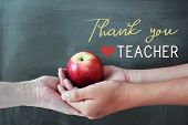Student And Teacher Hands Holding Red Apple With Chalkboard Background, Happy Teachers Day poster