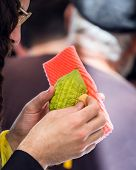Religious Jew with glasses chooses etrog for the holiday Sukkot. Jewish autumn holiday Sukkot - Feas poster