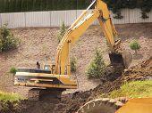 Excavator Dumps Dirt