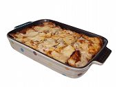 Lasagna in colorful ceramic casserole