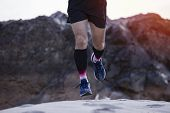 Young Fitness Man Trail Runner At Mountain ,man Jogging Through Landscape Mountains Background,trail poster