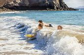 picture of papagayo  - boys have fun riding in the waves - JPG