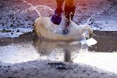 Man Trail Runner Running On The Mud, Water Splashes,man Jogging Through Landscape  Background, Trail poster