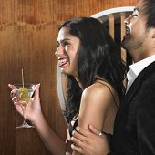 Multi-ethnic couple with martini