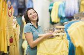 Hispanic teenage girl in clothing store