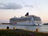 Ncl Cruiseship Leaves Honolulu Harbor At Dusk