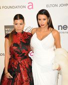 LOS ANGELES - FEB 24:  Kourtney Kardsahian, Kim Kardashian arrive at the Elton John 21st Academy Awards Viewing Party at the West Hollywood Park on February 24, 2013 in West Hollywood, CA