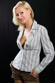 Attractive blond woman in an unbuttoned shirt
