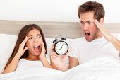 Oversleeping. Attractive young couple missed the ringing of the alarm clock and have overslept awake