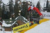 BUKOVEL, UKRAINE - FEBRUARY 23: Tanja Schaerer, Switzerland performs aerial skiing during Freestyle Ski World Cup in Bukovel, Ukraine on February 23, 2013.