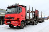 Red Unloaded Sisu Logging Truck