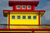 Yellow Building With Red Trim