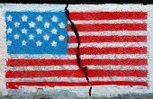 American flag on a cracked wall