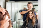 foto of hairspray  - Happy hairstylist setting up client - JPG