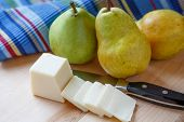 Pears And Sliced Cheese With Colorful Placemat