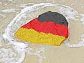 Flag Of Germany On A Stone On The Beach