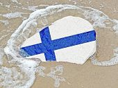 Flag Of Finland On A Stone On The Beach