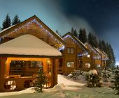 stock photo of house woods  - Beautiful ski chalets at night - JPG