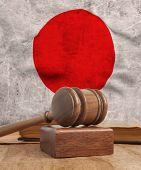 Wooden gavel and vintage Japan flag