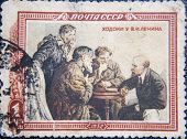 RUSSIA - CIRCA 1952: stamp printed by USSR at 1953 shows meeting of Lenin with three workers