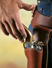 picture of gunfights  - cowboys hand at waist level reaching for gun as if to draw - JPG